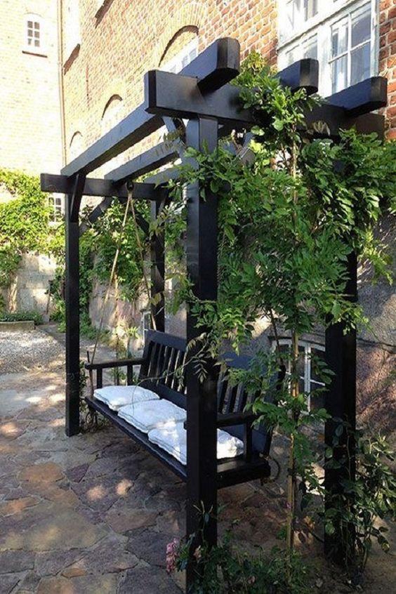 Banco de jardim de madeira preta