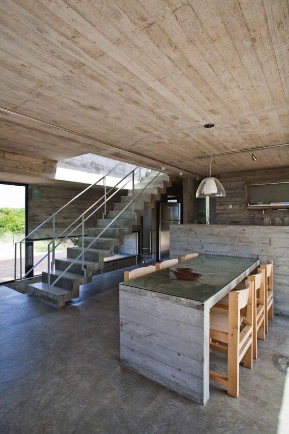 Casa industrial com porcelanato cimento queimado