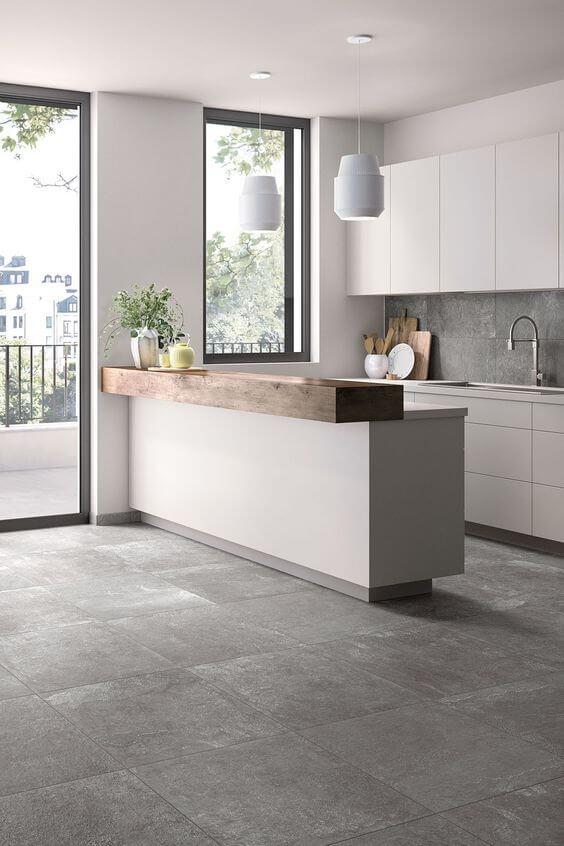 Cozinha americana com porcelanato cimento queimado