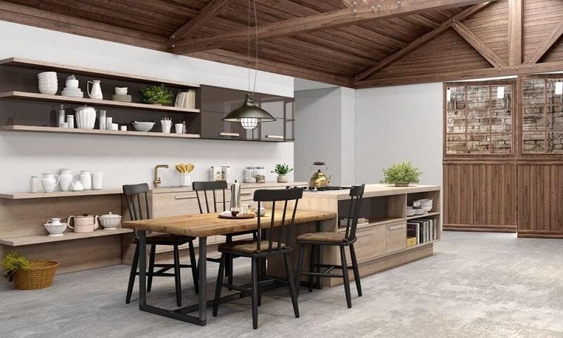 Cozinha gourmet com elementos em madeira e piso fosco de cimento queimado. Projeto de MovDecor