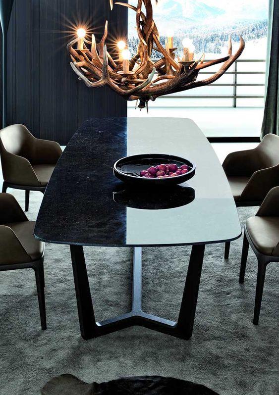 Mesa de granito preta com lustre rustico