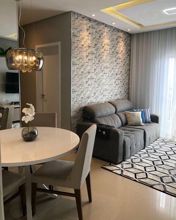 Mesa de granito redonda e branca com cadeira cinza