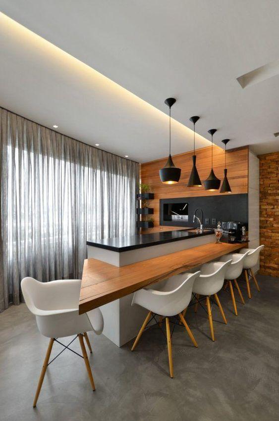 Porcelanato cimento queimado na cozinha moderna com poltrona branca