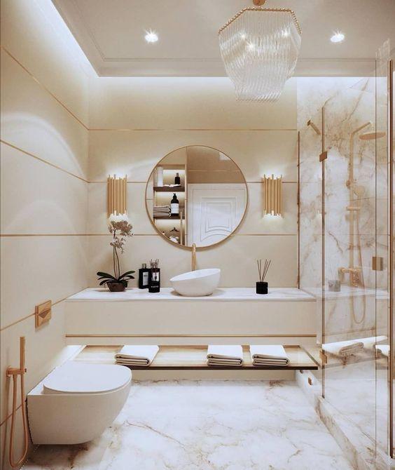 Porcelanato para banheiro feminino em cores claras e dourado