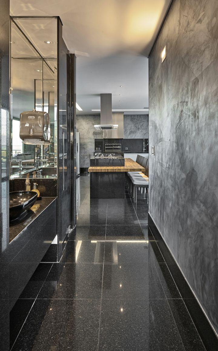 Porcelanato preto para casa moderna com parede de cimento queimado