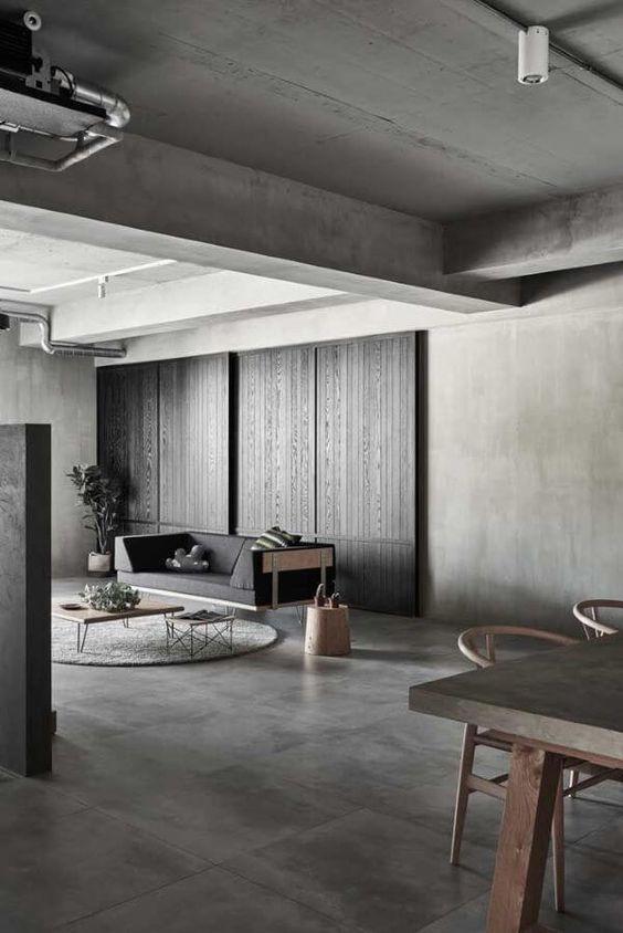 Sala de estar com porcelanato cimento queimado