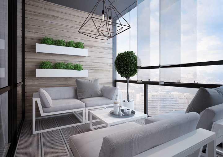 Varanda de vidro com móveis de estofados
