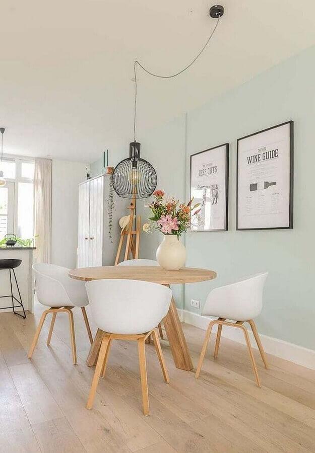 decoração clean com luminária decorativa para mesa de jantar redonda Foto Fashionismo