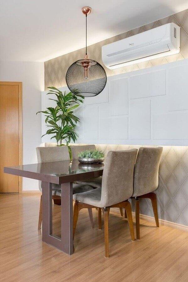 decoração de sala de jantar com luminária decorativa moderna Foto Cláudia Comparin
