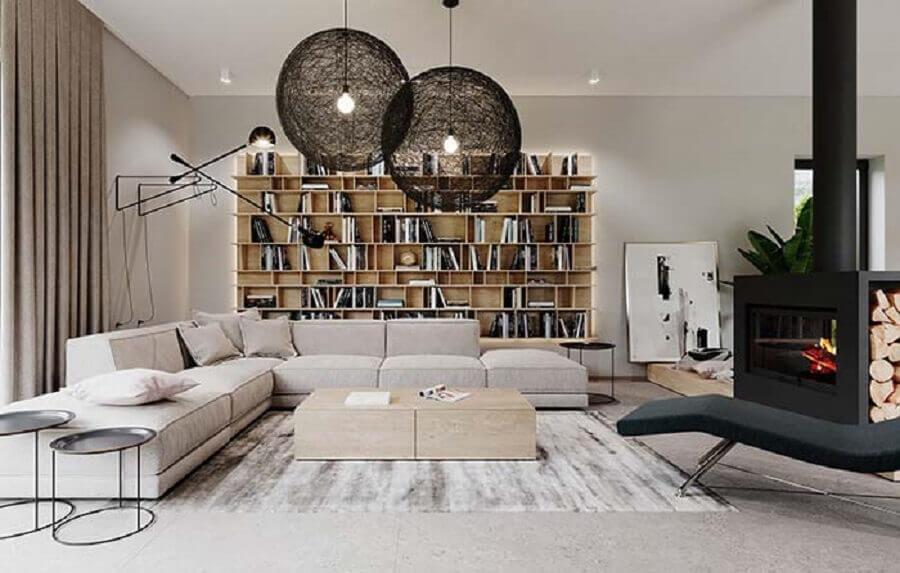decoração de sala de visita moderna com lareira preta e estante de livros Foto Pinterest