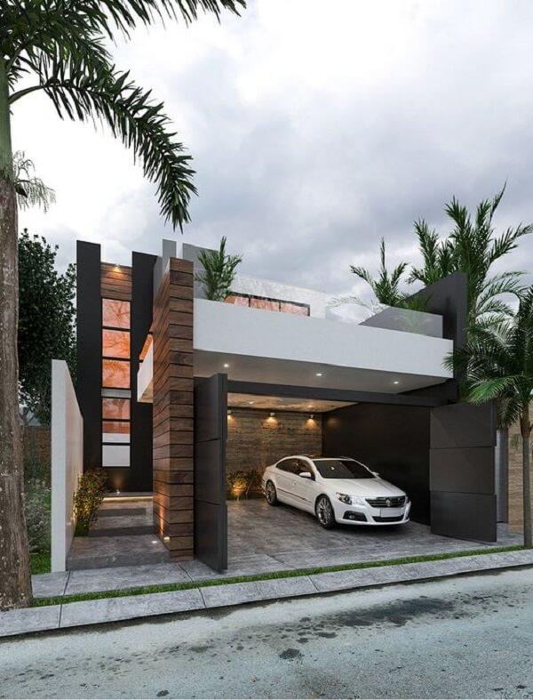 A iluminação pode destacar de maneira sofisticada a estrutura da garagem. Fonte: Pinterest