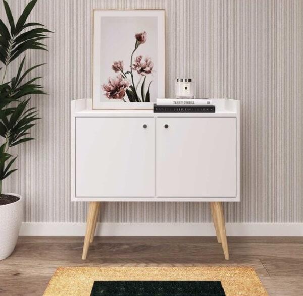 Decoração clean com aparador pé palito branco. Fonte: TricaeBr