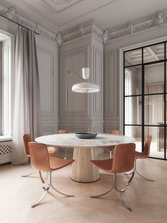 Mesa cone branca com cadeiras rose