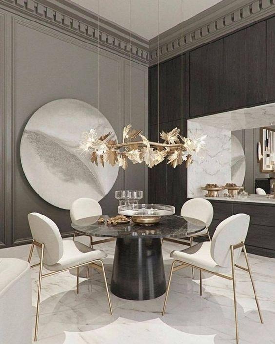 Mesa cone preta com lustre dourado
