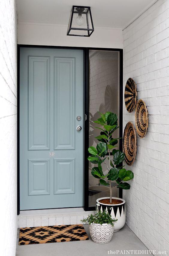 Porta de madeira para sala verde e branca