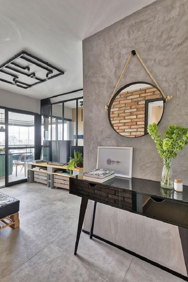 Sala estilo industrial com aparador pé palito preto. Fonte: Casa de Valentina