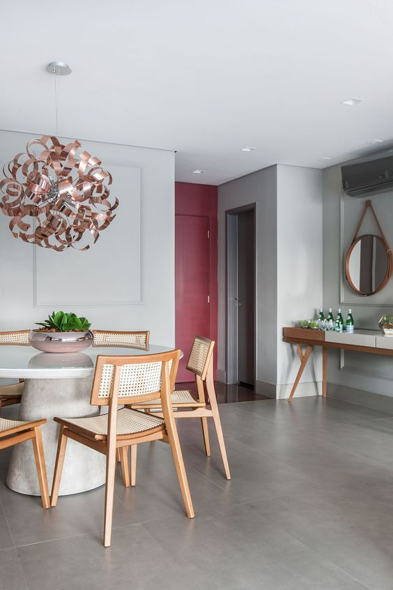 Sala moderna com mesa de jantar cone