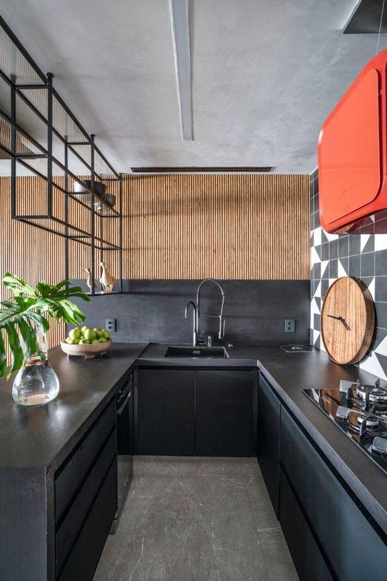 Bancada para cozinha em granito cinza escuro com armários preto e laranja, super moderno e vibrante