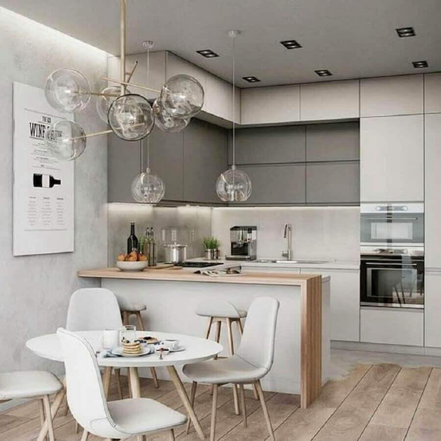 bancada de madeira e mesa redonda para decoração de cozinha americana com sala de jantar Foto Houzz