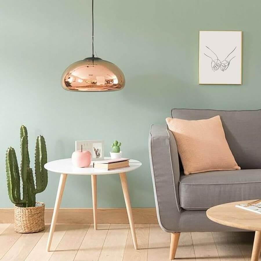 cores pastéis para sala de estar decorada com luminária rose gold Foto Pinterest