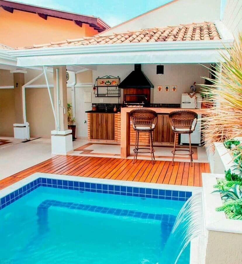 decoração de área gourmet com piscina e churrasqueira Foto Dcore Você