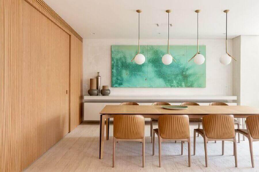 decoração de sala de jantar com luminária pendente moderna e quadro grande Foto Houzz