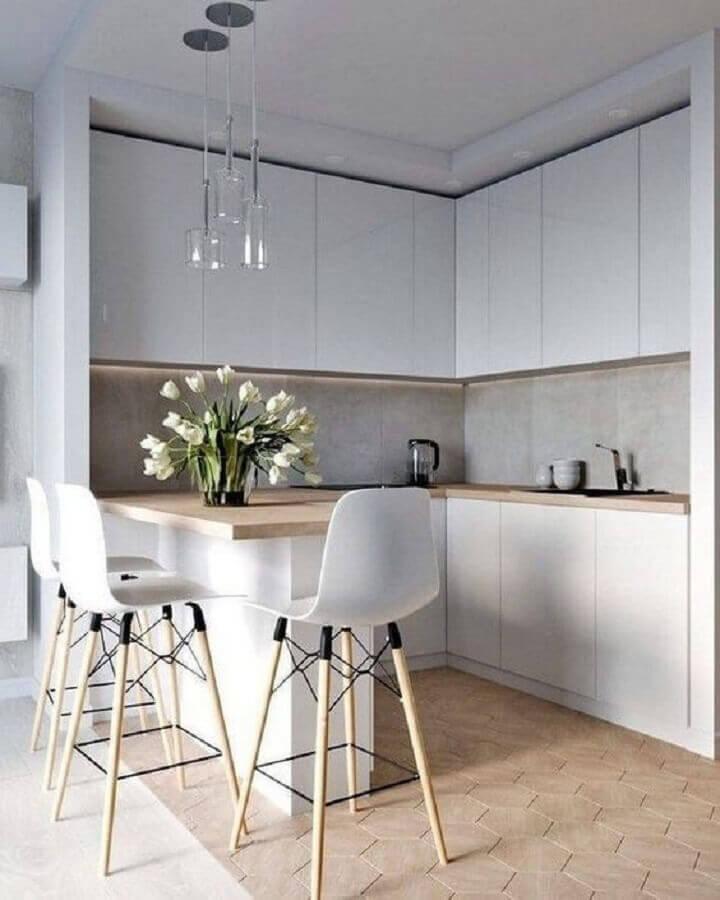 decoração minimalista para cozinha de canto com banqueta alta branca Foto Apartment Therapy