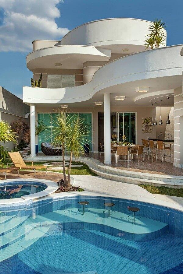 decoração sofisticada para casa com área gourmet com piscina Foto Homify