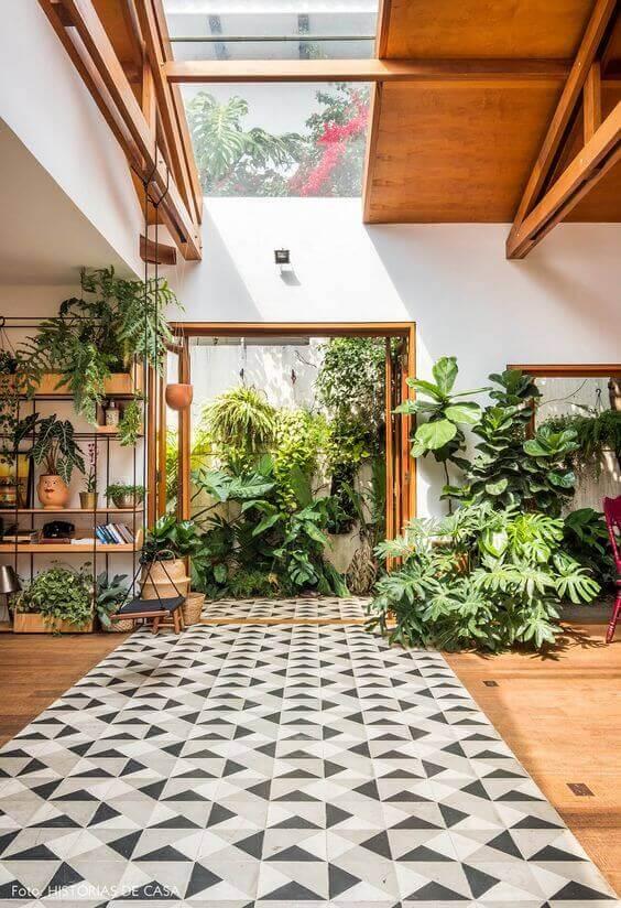 Sala de estar com jardim de inverno
