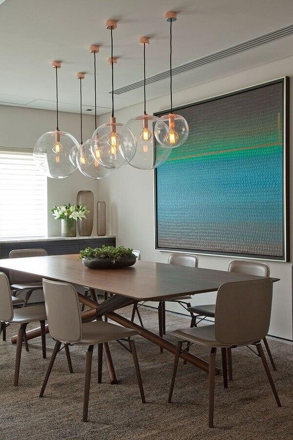 luminária pendente de vidro para sala de jantar moderna decorada com quadro grande Foto Casa de Valentina