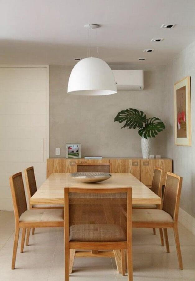 luminária pendente para mesa de jantar em sala decorada com parede de cimento queimado Foto Histórias de Casa