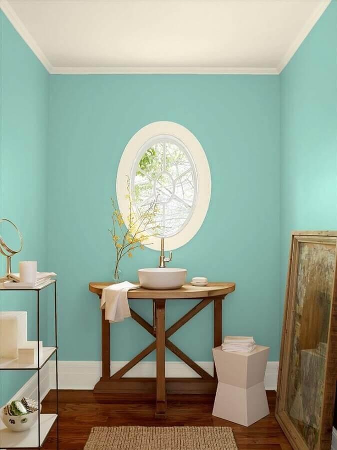 parede verde piscina para banheiro decorado com bancada de madeira Foto Pinterest