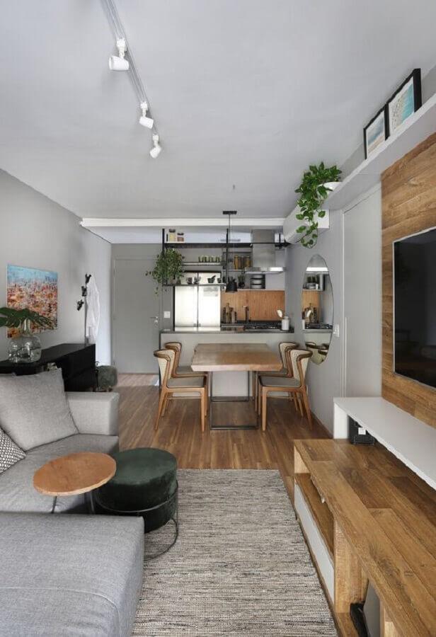 sala de apartamento decorada em tons de cinza com ambientes integrados Foto Fashion Bubbles