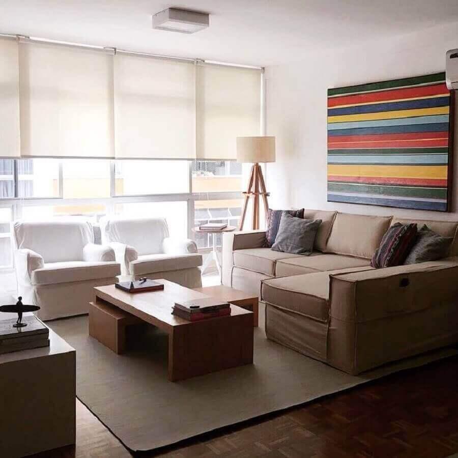 sala de estar apartamento decorada com quadro grande colorido Foto Jeito de Casa