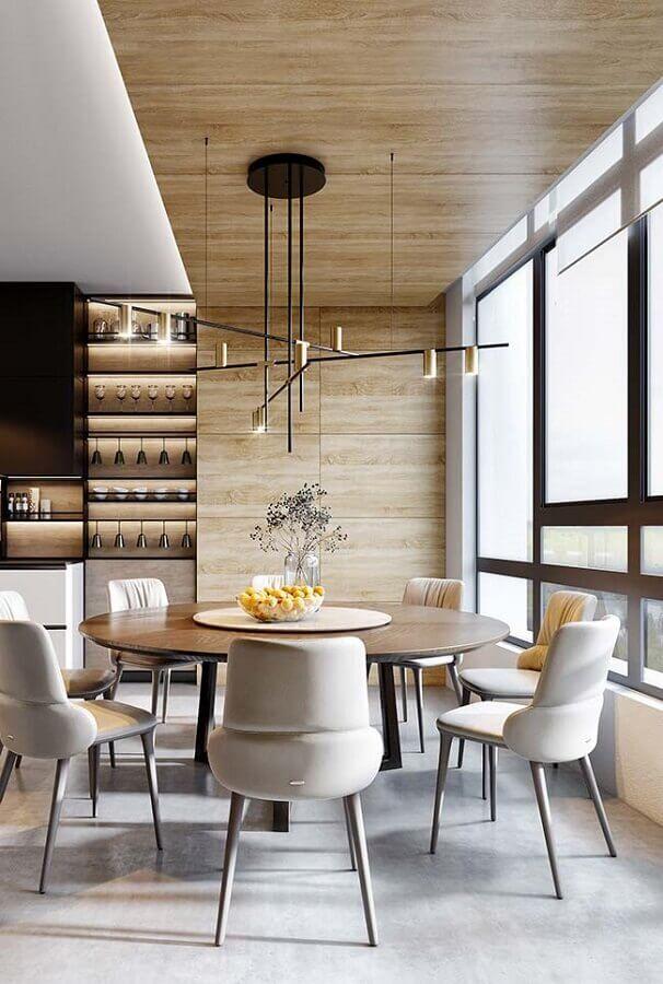 sala de jantar amadeirada decorada com cadeira de jantar moderna estofada Foto Futurist Architecture