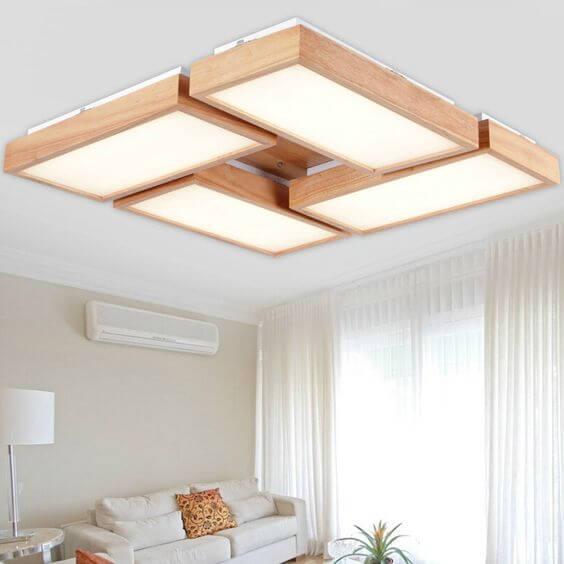 Lustre quadrado com madeira ao redor da iluminação
