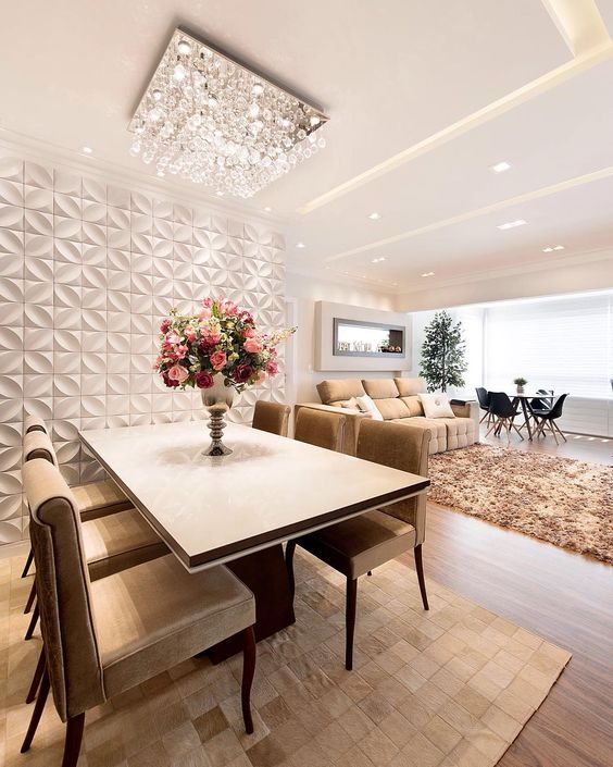 Parede de sala decorada com porcelanato 3D branco