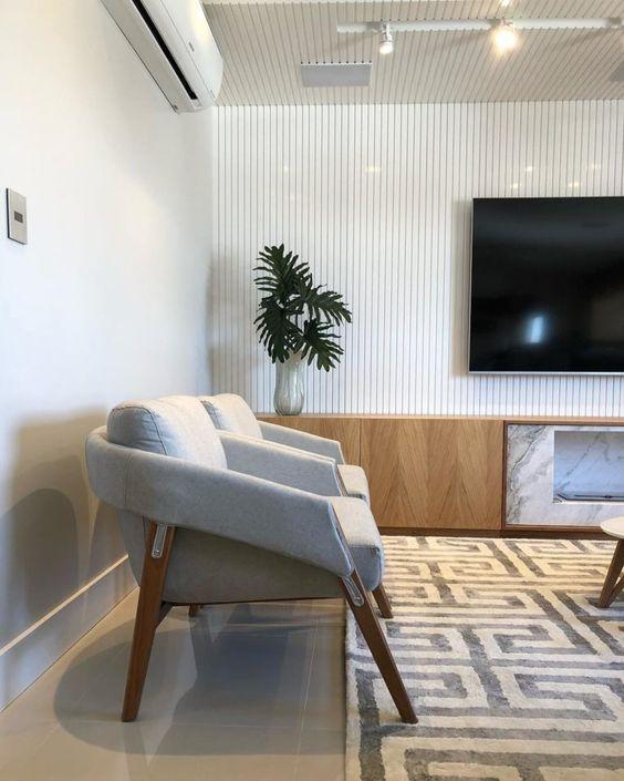 Poltronas para sala de espera com tv e decoração moderna