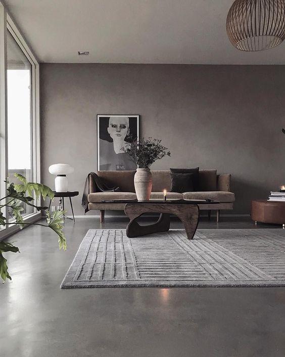 Sala de estar moderna com piso cimento queimado