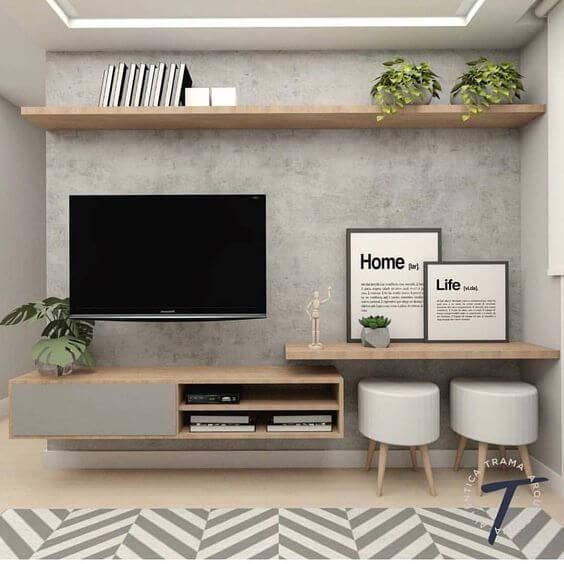 Sala decorada com parede de cimento queimado e móveis de madeira
