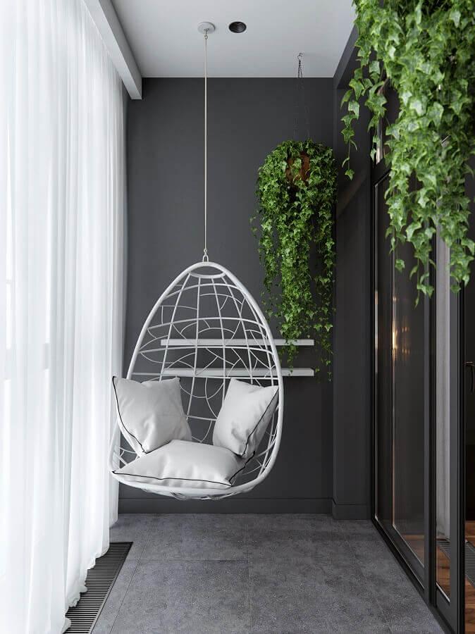 Cadeira de balanço suspensa para varanda cinza com decoração moderna Foto Behance
