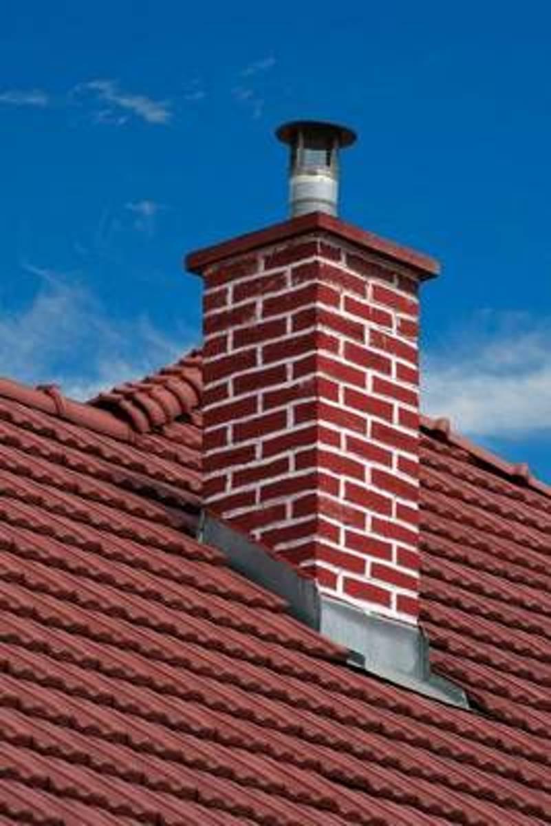 Casa com chamine no telhado