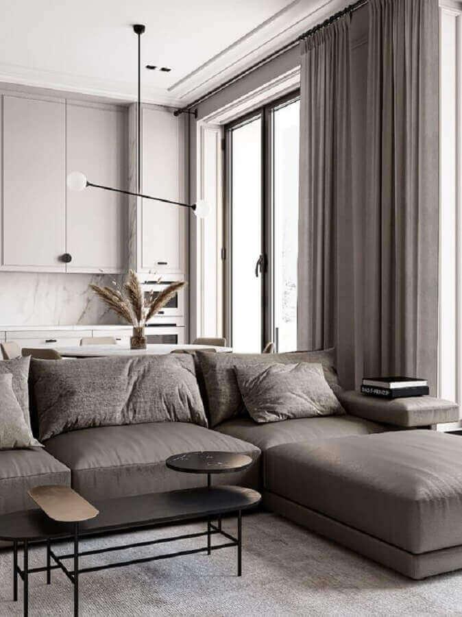Luminárias modernas para sala grande decorada na cor cinza integrada com a cozinha