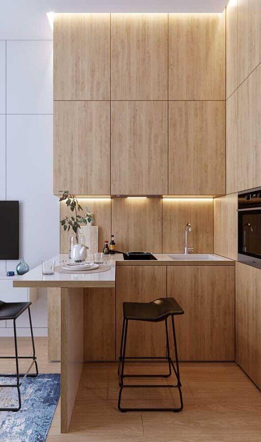 móveis planejados para decoração de cozinha estilo americana pequena amadeirada Foto Apartment Therapy