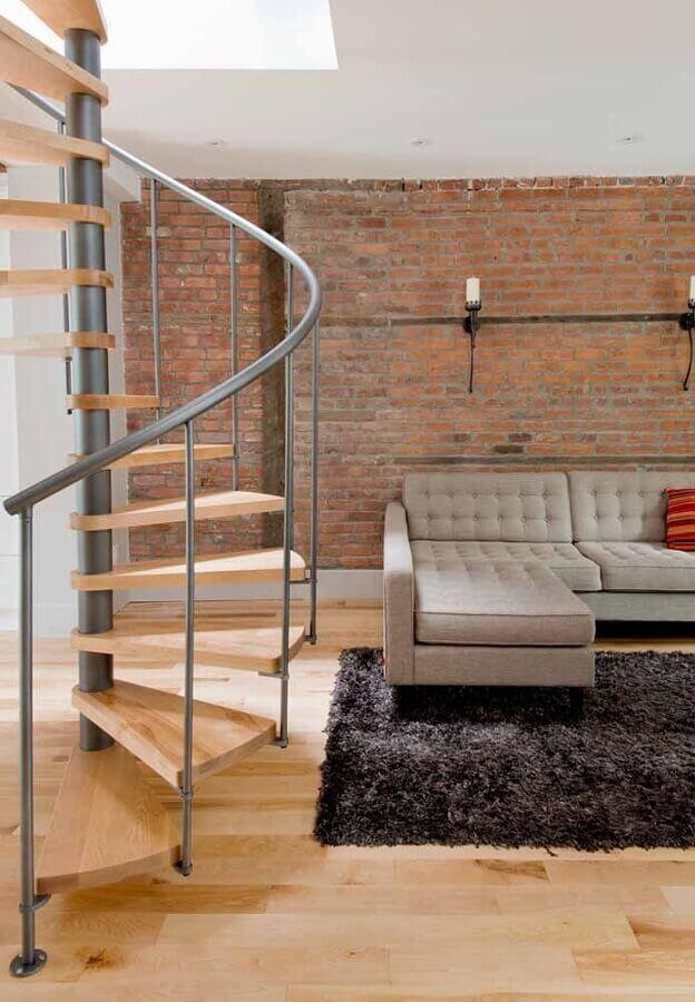 parede tijolinho para sala decorada com escada espiral de madeira e inox Foto Pinterest