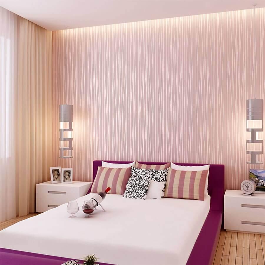 quarto de casal decorado com papel de parede rosa chá Foto Arkpad