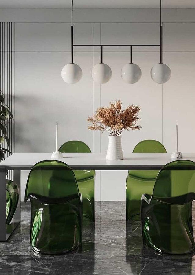 Sala de jantar moderna decorada com cadeira verde de acrílico Foto Futurist Architecture
