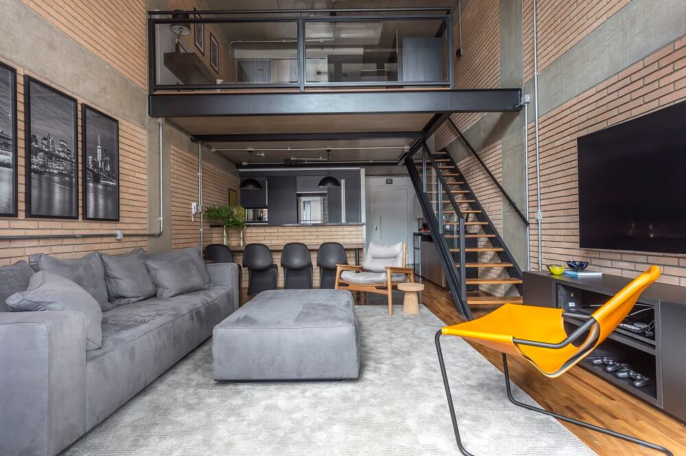 O loft já contava com uma essência industrial. Foto: JP Image