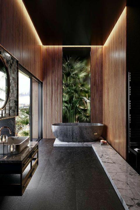 Banheiro com piso de ardósia preta e banheira cinza