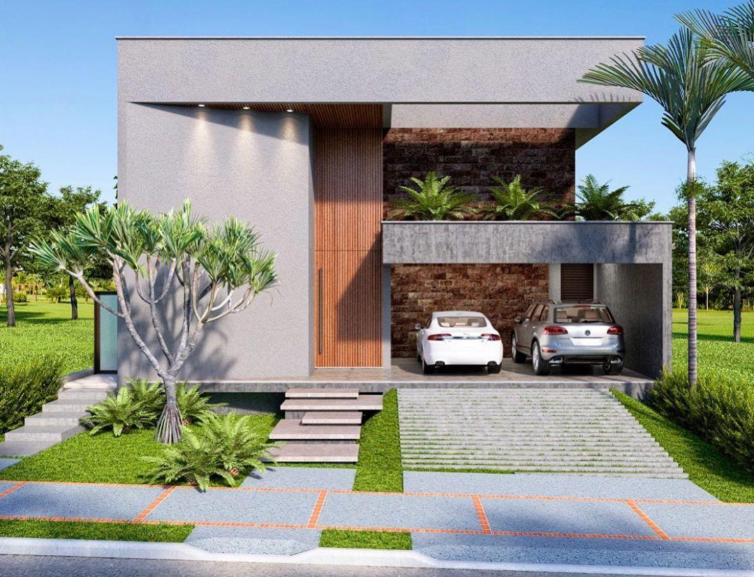 Casa com modelos de garagem para dois carros e rampa